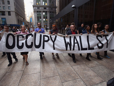 Protesters march near the New York Stock Exchange during a demonstration marking the one-year anniversary of the Occupy Wall Street movement on September 17, 2012 in New York City. (John Moore/Getty Images/AFP)
