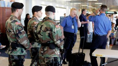 Massachusetts National Guardsmen 192nd MP's observe passengers at a boarding gate at Logan International Airport in Boston (Reuters / Pool)