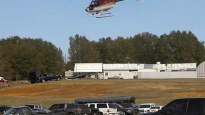 A Dale County Alabama helicopter flies over the scene of a shooting and hostage taking near Midland City, Alabama February 1, 2013. (Reuters / Philip Sears)
