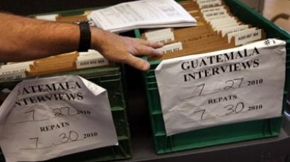 Folders for illegal immigrants flown back to Guatemala on a repatriation flight await to be filed at the U.S. Immigration and Customs Enforcement (ICE) detention facility for illegal immigrants in Florence, Arizona. (John Moore/Getty Images/AFP )