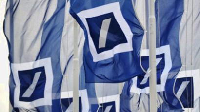 Flags with the logo of German bank Deutsche Bank. (AFP Photo / Arne Dedert)