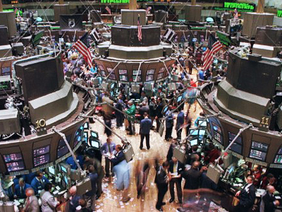 A general view of the floor of the New York Stock Exchange shows brokers and trading booths at the close of trading (AFP Photo / Jon Levy)