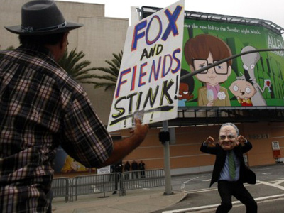 Protesters demonstrate the annual shareholder meeting of News Corp at Fox Studios (Eric Thayer / Getty Images / AFP)