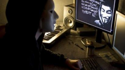 A masked hacker, part of the Anonymous group (AFP Photo / Jean-Philippe Ksiazek)