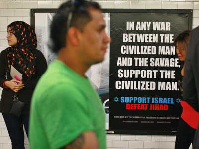 """Commuters walk by an advertisement that reads """"Support Israel/Defeat Jihad"""" in the Times Square subway station in New York, September 24, 2012.  (Reuters/Brendan Mcdermid)"""