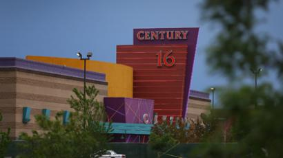 The Century 16 movie theatre is seen from a memorial setup across the street on July 28, 2012 in Aurora, Colorado (AFP Photo / Joe Raedle)