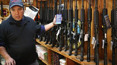 Jason Zielinski shows a customer a selection of AR-15 style rifles being offered for sale at Freddie Bear Sports sporting goods store on December 17, 2012 in Tinley Park, Illinois. (Scott Olson/Getty Images/AFP)