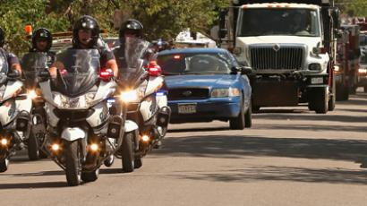 Aurora Police Department motorcycles escort a dump truck filled with sand and improvised explosive devices removed from James Holmes' apartment July 21, 2012 in Aurora, Colorado (AFP Photo / Chip Somodevilla)