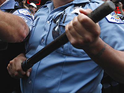Police officers hold batons  (Reuters / Eric Thaye)