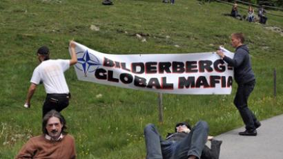 Activists protest close to the Suvretta House five-star hotel in the chic Swiss ski station of St Moritz, where the Bilderberg Group is holding its annual meeting on June 9, 2011 (AFP Photo/Fabrice Coffrini)
