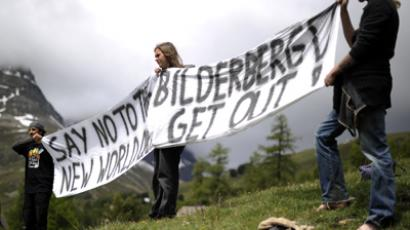 Activists protest on June 9, 2011 in front of the Suvretta House five-star hotel in the chic Swiss ski station of St Moritz, where the Bilderberg Group is holding its annual meeting (AFP Photo / Fabrice Coffrini)