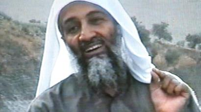 This frame grab from the Saudi-owned television network MBC (Middle East Broadcasting Center) shows alleged terror mastermind Osama bin Laden gesturing an undated videotape broadcast by the Dubai-based MBC 17 April 2002. (AFP Photo / MBC)