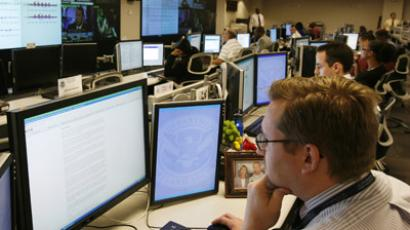 U.S. Department of Homeland Security analysts work at the National Cybersecurity & Communications Integration Center (NCCIC) located just outside Washington in Arlington, Virginia (Reuters/Hyungwon Kang)