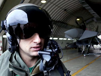 "Italy, Sigonella : A Eurofighter Typhoon Italian jet's pilot who might take part in the UN-mandated operation ""Odissey Dawn"" (AFP Photo / Giovanni Marino)"