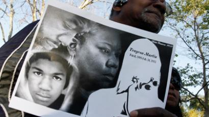 Freddie Muse holds a sign at a rally to call for justice in the murder of Trayvon Martin at Leimert Park in Los Angeles, California, March 22, 2012 (Reuters / Jonathan Alcorn)