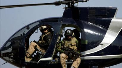 In a file picture dated 05 February 2005, members of the US-based Blackwater private security firm scan Baghdad city centre from their helicopter.(AFP Photo / Marwan Naamani)