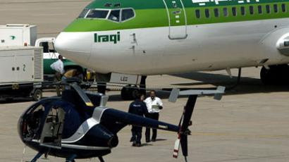 A helicopter belonging to the US security firm Blackwater is seen parked near Iraqi airway plane preparing to take off at Baghdad International Airport 18 September 2004.(AFP Photo / Ahmad Al-Rubaye)