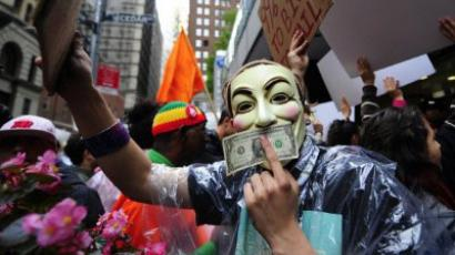 New York : Occupy Wall Street members stage a protest march near Wall Street in New York, on October 12, 2011. (AFP Photo/Emmanuel Dunand )
