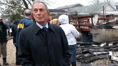 New York City Mayor Michael Bloomberg views damage in the Breezy Point area of Queens in New York on October 30, 2012. (AFP Photo)