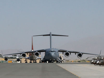 A US Air Force Boeing C 17 Globemaster freight transport airplane remains on the tarmac at the Kabul International airport, in Kabul, on August 4, 2012.(AFP Photo / Alexander Klein)