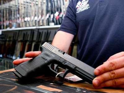 'Business is Booming': Gun store owner who banned Obama supporters sees surge in sales