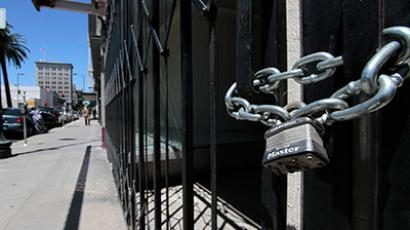 Shuttered and padlocked businesses line Main Street in Stockton, California June 27, 2012 (Reuters/Kevin Bartram)