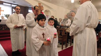 Iraqi catholics, including some of the wounded in a deadly Al-Qaeda hostage crisis at a Baghdad church on October 31 and came to France for treatment since, attend the Christmas mass on December 26, 2010 at Paris chaldean church. (AFP Photo/Pierre Verdy)
