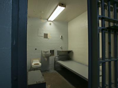 An empty jail cell awaits a new prisoner