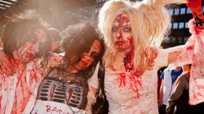 Horror movie culture enthusiasts dressed as zombies take part in the Helsinki Zombie Walk in Central Helsinki (REUTERS/Lehtikuva Lehtikuva)