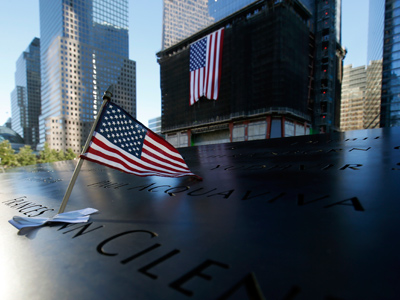 An American flag stands stuck in a plaque of names of the victims of the September 11 attacks at the North Pool of the 9/11 Memorial (AFP Photo / Mike Segar)