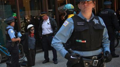 A woman is detained by police while taking part in a march in protest of NATO Summit in Chicago May 21, 2012 (Reuters/Adrees Latif)