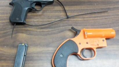 A ..22 caliber handgun, its magazine and a flare gun seized by police from a seven-year-old boy at Wave Preparatory Elementary School in New York are pictured in this handout photo released by the NYPD January 17, 2013.(Reuters / Handout)