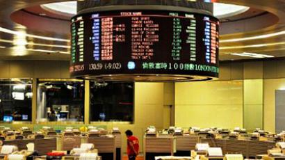A trader walks the floor of the Hong Kong Stock Exchange on August 3, 2011