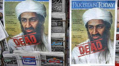 A roadside vendor sells newspapers with headlines about the death of al-Qaeda leader Osama bin Laden, in Lahore May 3, 2011. (Reutres / Mohsin Raza)