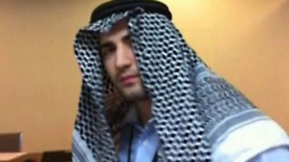 "A grab taken from a video aired by the official Iranian state TV on December 18, 2011 shows one of several photos of a young man alleged to be a captured CIA spy of Iranian origin confessing to a ""mission"" to infiltrate the intelligence ministry, wearing a traditional Arab garb (AFP Photo)"