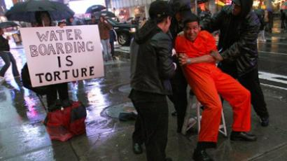"Demonstrators from the group ""World Can't Wait"" hold a mock waterboarding torture of a prisioner in Times Square (AFP Photo / Timothy A. Clary)"