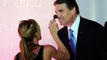Rick Perry gets touched up during a break in the Ronald Reagan Centennial GOP Presidential Primary Debate at the Ronald Reagan Presidential Library on September 7, 2011. (Kevork Djansezian/Getty Images/AFP)