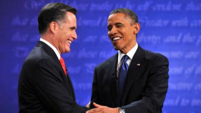 US President Barack Obama (R) and Republican challenger Mitt Romney shake hands following their first debate at the University of Denver in Denver, Colorado, October 3, 2012. (AFP Photo / Nicholas Kamm)