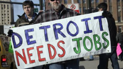 "Transport worker carries a ""Detroit Needs Jobs"" sign as he joins a demonstration in Detroit, Michigan January 8, 2012.  (Reuters / Rebecca Cook)"