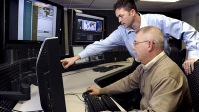 US Department of Homeland Security (DHS) employees work on the Industrial Control Systems Cyber Emergency Response Team (ICS-CERT) operational watch floor where they monitor, track, and investigate cyber incidents (Reuters / Chris Morgan / Idaho National Laboratory)