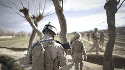 Afghanistan, Musa Qala: US Marines from 1st Battalion, 8th Marines walk during a foot patrol outside Musa Qala District Center base on January 28, 2011 in Musa Qala. (AFP Photo / Dmitry Kostyukov)