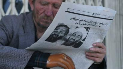 An Afghan man reads a newspaper on a street of Kabul on May 3, 2011, which details the death of Al-Qaeda leader Osama bin Laden. (AFP Photo/Massoud Hossaini)
