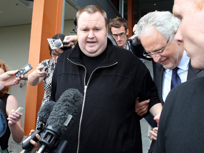 Megaupload boss Kim Dotcom leaves court after he was granted bail in the North Shore court in Auckland on February 22, 2012 (AFP Photo / Michael Bradley)