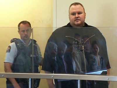 This video grab taken from pool video footage shows Megaupload founder Kim Dotcom (R), attending the North Shore court in Auckland on January 25, 2012 (AFP Photo)