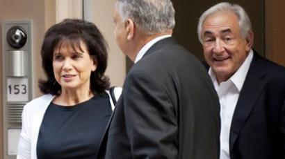 Dominique Strauss-Kahn (R) and his wife Ann Sinclair (AFP Photo / Don Emmert)