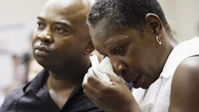 Elaine Riddick, right, is comforted Wednesday by her son Tony Riddick during the Justice for Sterilization Victims Foundation task force compensation hearing in Raleigh (AFP Photo / Getty Images)