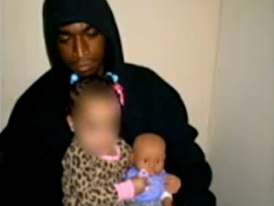 Man arrested for posing with baby and BB gun on Facebook photo