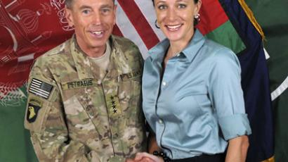 David Petraeus shakes hands with author Paula Broadwell in this ISAF handout photo originally posted July 13, 2011. (Reuters/ISAF/Handout)