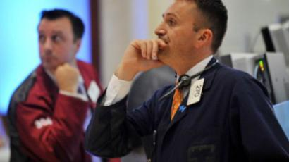 "Traders watch the announcement that the US Federal Reserve Bank will leave interest rates ""exceptionally low"" until 2013 on the floor of the New York Stock Exchange on August 9, 2011 (AFP Photo / Stan Honda)"