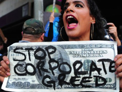 An anti-Wall Street demonstrator shouts slogans in front of the Federal Reserve Bank (AFP Photo / Frederic J. Brown)